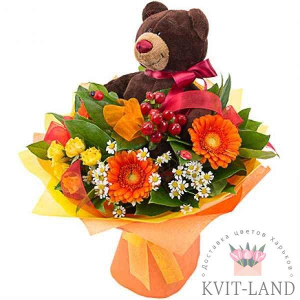 мягкая игрушка в букете цветов