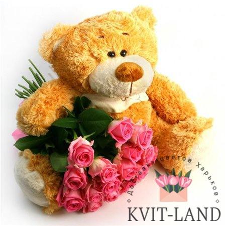 мишка игрушка держит букет роз